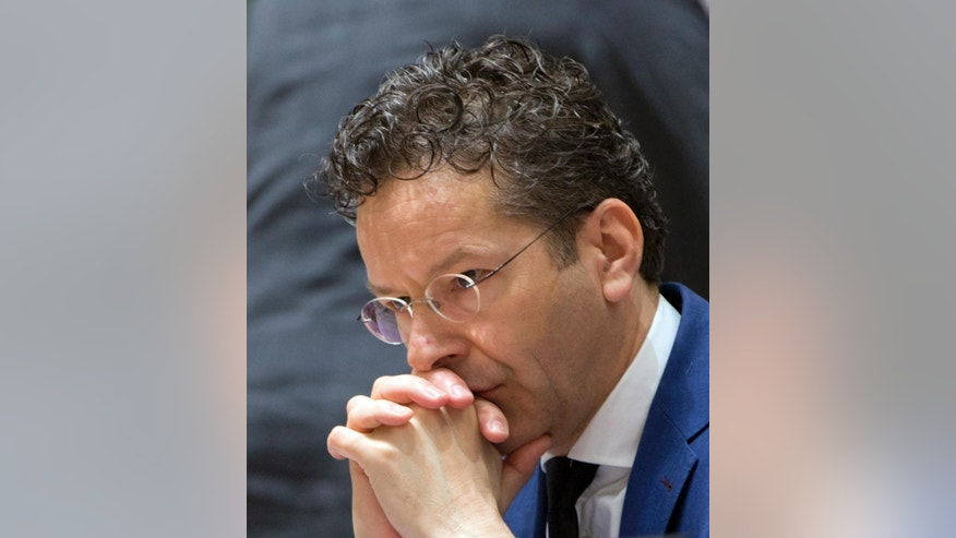 Dutch Finance Minister Jeroen Dijsselbloem waits for the start of a meeting of EU finance ministers at the Europa building in Brussels on Tuesday, March 21, 2017. (AP Photo/Virginia Mayo)