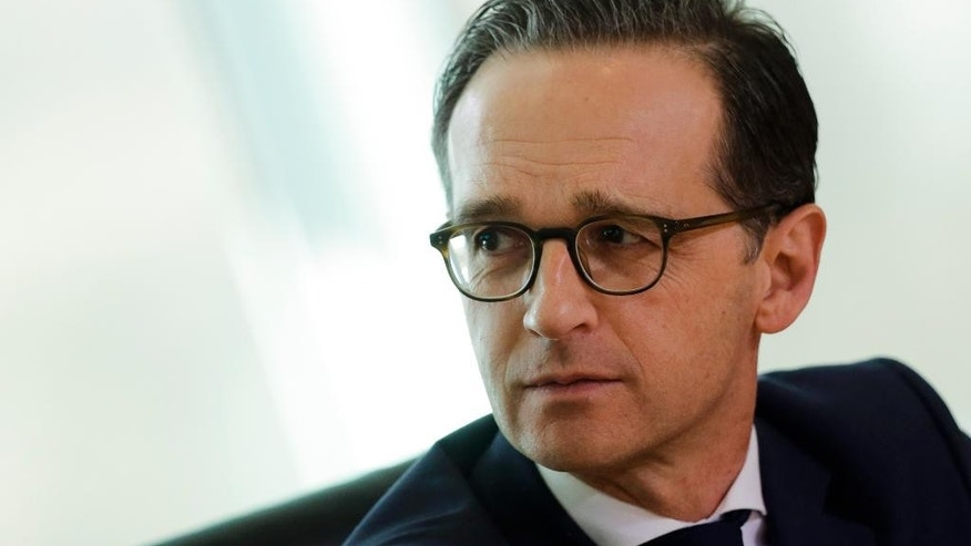 German Justice Minister Heiko Maas attends the weekly cabinet meeting of the German government at the chancellery in Berlin, Wednesday, March 22, 2017. Germany's Cabinet on Wednesday approved a bill that will annul the convictions of thousands of gay men under a law criminalizing homosexuality that was applied zealously in post-World War II West Germany. (AP Photo/Markus Schreiber)