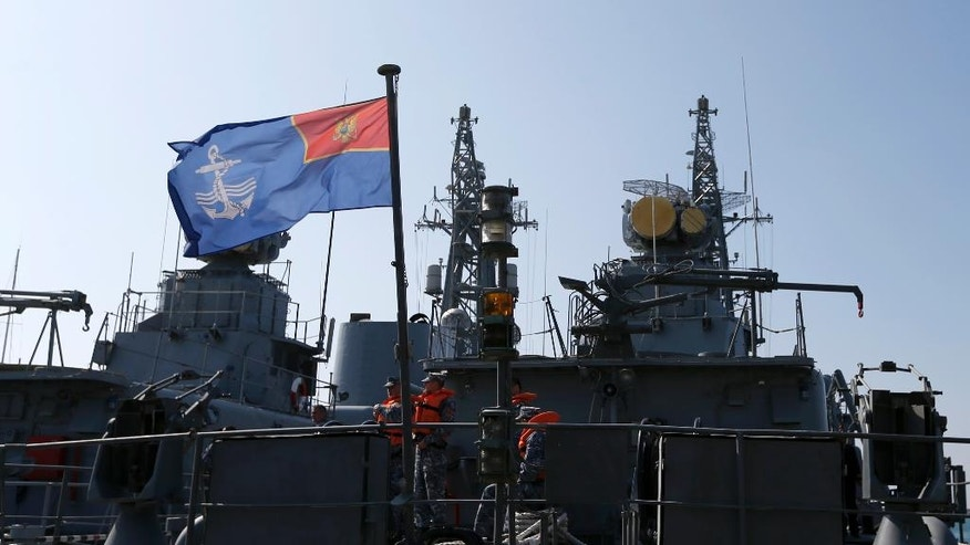 "Montenegrin sailors stand at the light frigate ""Kotor"" in the harbour of Bar, Montenegro, Wednesday, March 15, 2017.  Aspiring NATO member Montenegro is hardly a formidable military force, the tiny country's four military jets are up for sale and its two operational warships hardly ever leave their home port, but  Montenegro has found itself in the middle of a major row between the West and Moscow. (AP Photo/Darko Vojinovic)"
