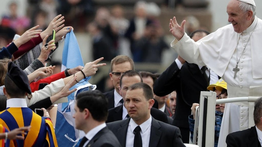 Pope Francis waves to faithful as he arrives in St. Peter's Square at the Vatican for his weekly general audience, Wednesday, March 22, 2017. (AP Photo/Gregorio Borgia)