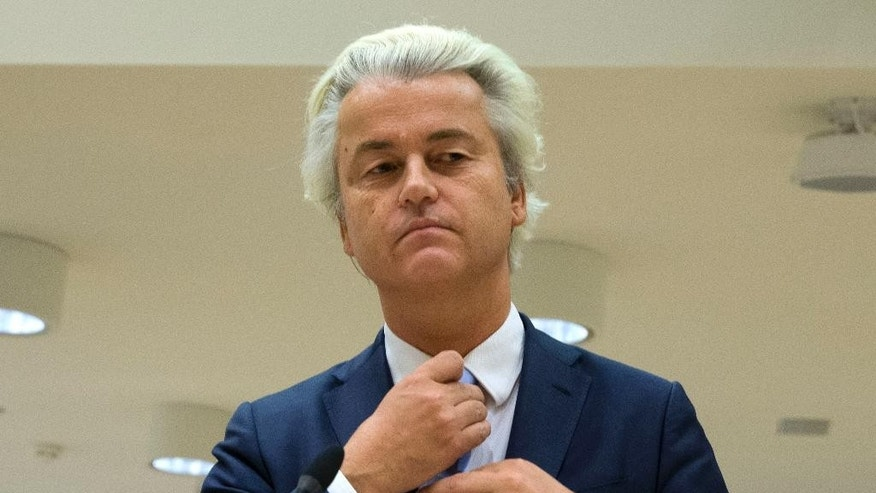 FILE - In this Nov. 23, 2016 file photo, populist anti-Islam lawmaker Geert Wilders prepares to address judges at the high-security court near Schiphol Airport in Amsterdam, during his hate-speech trial that pits freedom of expression against the Netherlands' anti-discrimination laws. Wilders said on Wednesday, March 22, 2017, that political parties discussing the make-up of the next Dutch ruling coalition are shutting him out and sidelining 1.3 million people who voted for his party in last week's parliamentary election. (AP Photo/Peter Dejong, File)