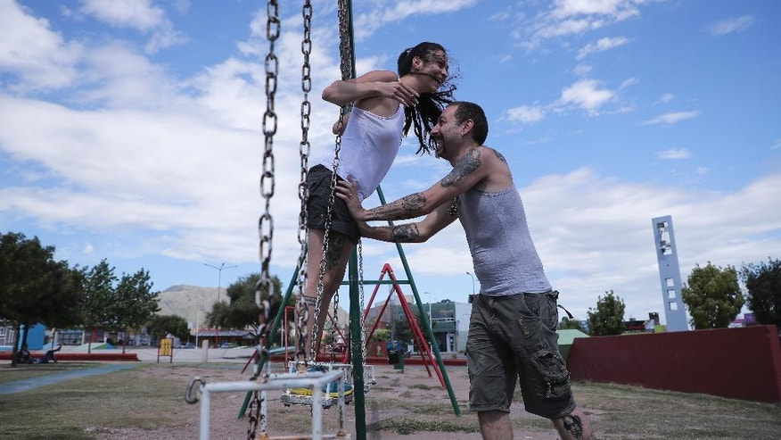 "In this March 14, 2017, Syrian couple Lana S. and Majd M, play at a park in La Punta, San Luis, Argentina. Lana and Majd are the first couple who arrived here under San Luis's migrant program. Majd, a cook who wants to open a restaurant in San Luis, said he felt like he was nothing in Syria, ""but here, I feel like I can do many things ... I can do anything: I can learn the language, I can learn from Argentina, and from its people."" (AP Photo/Nicolas Aguilera)"