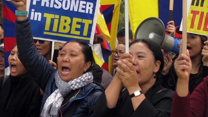"Free Tibet protesters demonstrate outside Australia's Parliament House on Thursday, March 23, 2017, in Canberra, Australia, ahead of the arrival of Chinese Premier Li Keqiang. Li arrived in Canberra on Wednesday on a mission to expand bilateral ties as U.S. President Donald Trump proposes an ""America First"" overhaul of global trade. (AP Photo/Rod McGuirk)"