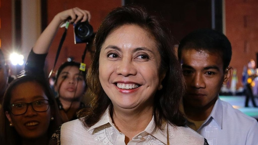 "Philippine Vice President Maria Leonor ""Leni"" Robredo smiles during the 16th National Convention of the Integrated Bar of the Philippines in Pasay, south of Manila, Philippines on Thursday, March 23, 2017. House Speaker Pantaleon Alvarez recently said, he is mulling to file impeachment complaint against Robredo for sending a video message to the United Nations Side Session at the Commission on Narcotic Drugs Annual Meeting allegedly criticizing extra-judicial killings in the so-called war on drugs by President Rodrigo Duterte. Duterte himself is the object of an impeachment complaint filed by another congressman for the thousands of alleged killings in the country. (AP Photo/Aaron Favila)"