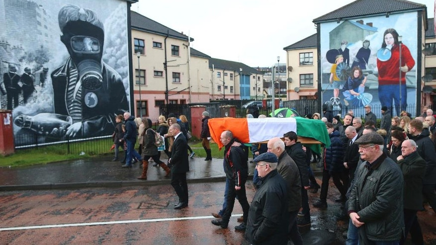 Irish Republicans carry the coffin of Martin McGuinness through the bogside area of Londonderry, Northern Ireland, Tuesday, March, 21, 2017. Martin McGuinness, the Irish Republican Army warlord who led his underground, paramilitary movement toward reconciliation with Britain, and was Northern Ireland's deputy first minister for a decade in a power-sharing government, has died, his Sinn Fein party announced Tuesday on Twitter. He was 66.(AP Photo/Peter Morrison)