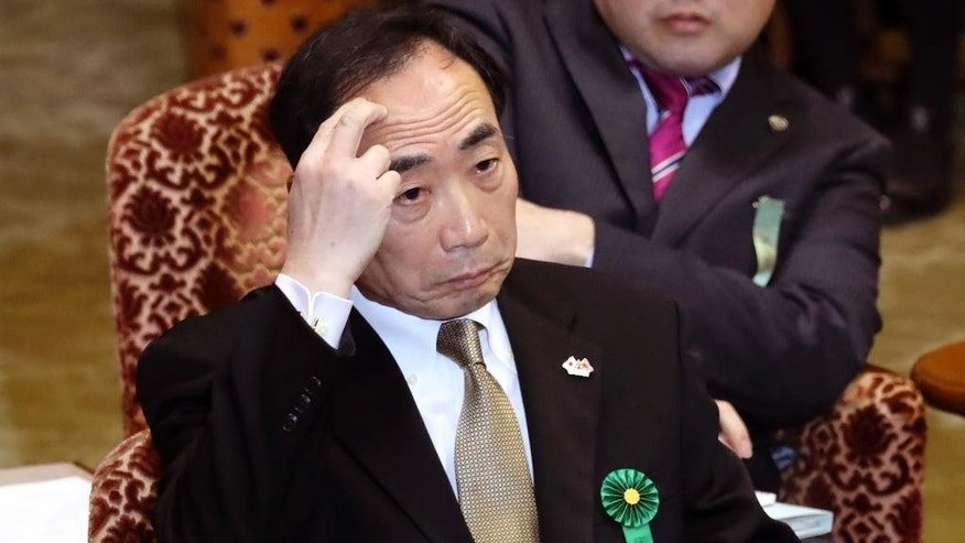 Yasunori Kagoike, head of an ultra-nationalistic Japanese school operator, gestures as he testifies before an upper house panel at the parliament in Tokyo, Thursday, March 23, 2017. Kagoike, at the center of a land and political scandal, testified in parliament that Prime Minister Shinzo Abe donated 1 million yen ($9,000) through his wife for an elementary school where she once was honorary principal. (AP Photo/Eugene Hoshiko)