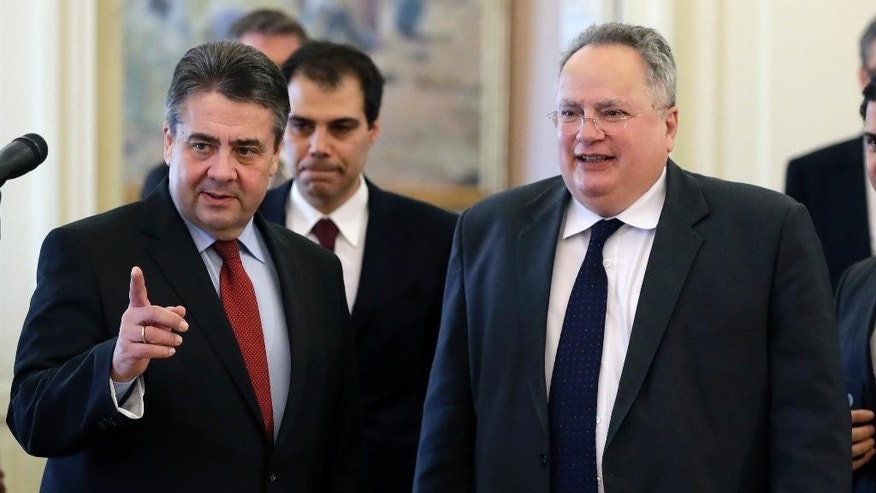 "German Foreign Minister Sigmar Gabriel, left, and his Greek counterpart Nikos Kotzias arrive for a press conference in Athens, Thursday, March 23, 2017. Gabriel described Wednesday events in London as an ""attack at heart of democracy."" (AP Photo/Thanassis Stavrakis)"