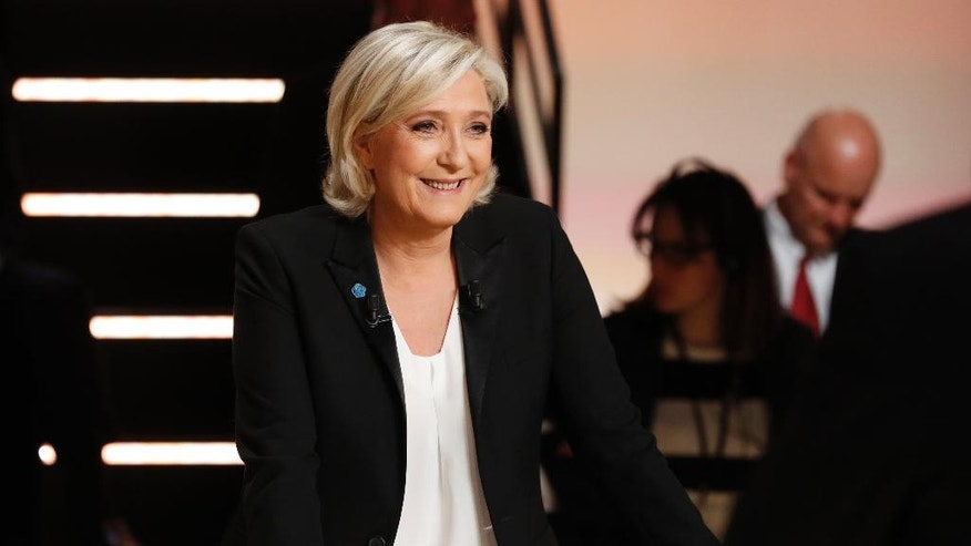 Far-right presidential candidate for the presidential election Marine Le Pen smiles prior to a television debate at French TV station TF1 in Aubervilliers, outside Paris, France, Monday, March 20, 2017. The five leading candidates for France's presidential election are holding their first debate Monday, with centrist Emmanuel Macron and far-right leader Marine Le Pen leading polls and jobs and security among voters' top concerns. (Patrick Kovarik/Pool Photo via AP)