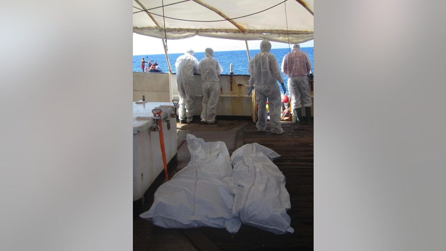 In this photo released by Proactiva Open Arms NGO on Friday, March 24, 2017, the bodies of two migrants on board the Golfo Azzurro, the Spanish NGO Proactiva Open Arms rescue ship on the Mediterranean Sea off the Libyan coast, during a search and rescue operation by Spanish NGO Proactiva Open Arms. A Spanish aid organization says it fears hundreds of migrants may have died off the coast of Libya after five bodies were found near two capsized boats and the search for a third vessel reported missing had so far proved futile. (Proactiva Open Arms via AP)
