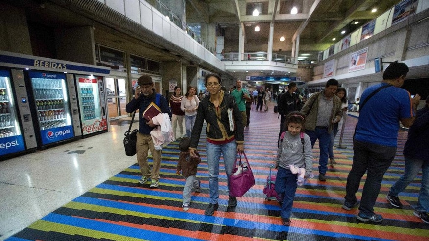 In this March 17, 2017 photo, Jewish converts Sahir Quitero, center, her husband Franklin Perez, son Ezra, left, and daughter Hannah, walk to departures lounge of the Simon Bolivar International Airport in Maiquetia, Venezuela, on their way to Israel. Their journey almost fell apart when late last year, after months of correspondence with officials in Israel, they were denied entry over concerns they weren't involved enough with Venezuela's Jewish community and were looking to take advantage of Israel's immigration policies to flee the troubled South American nation. (AP Photo/Fernando Llano)