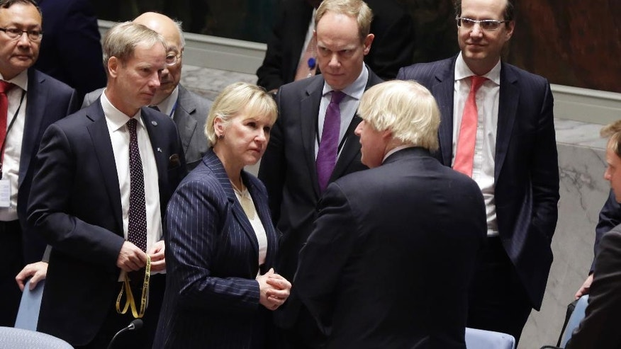 Britain's Foreign Minister Boris Johnson, right, talks with Sweden's Foreign Minister Margot Wallstrom in the United Nations Security Council, Thursday, March 23, 2017. (AP Photo/Richard Drew)