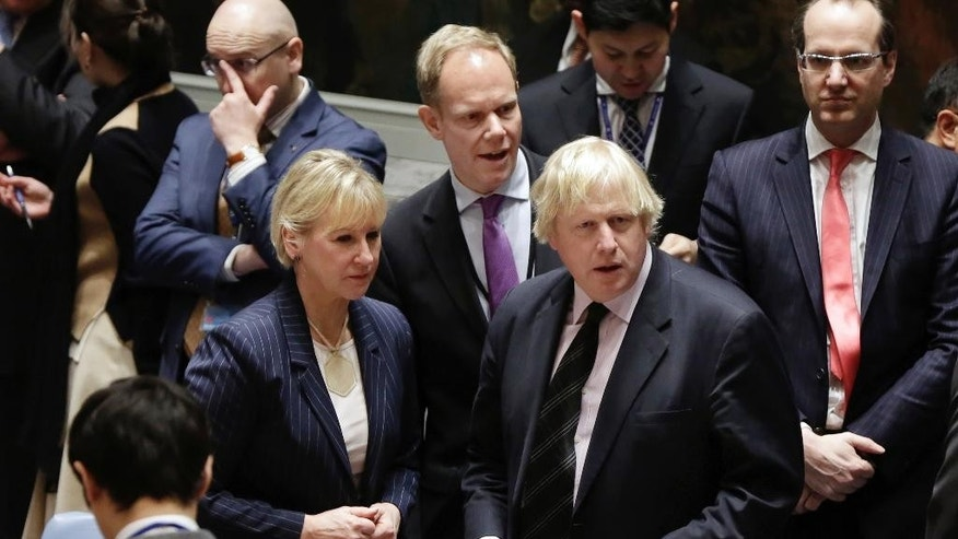 Britain's Foreign Minister Boris Johnson, right, meets with Sweden's Foreign Minister Margot Wallstrom in the United Nations Security Council, Thursday, March 23, 2017. Britain's Ambassador Matthew Rycroft is at background center.(AP Photo/Richard Drew)