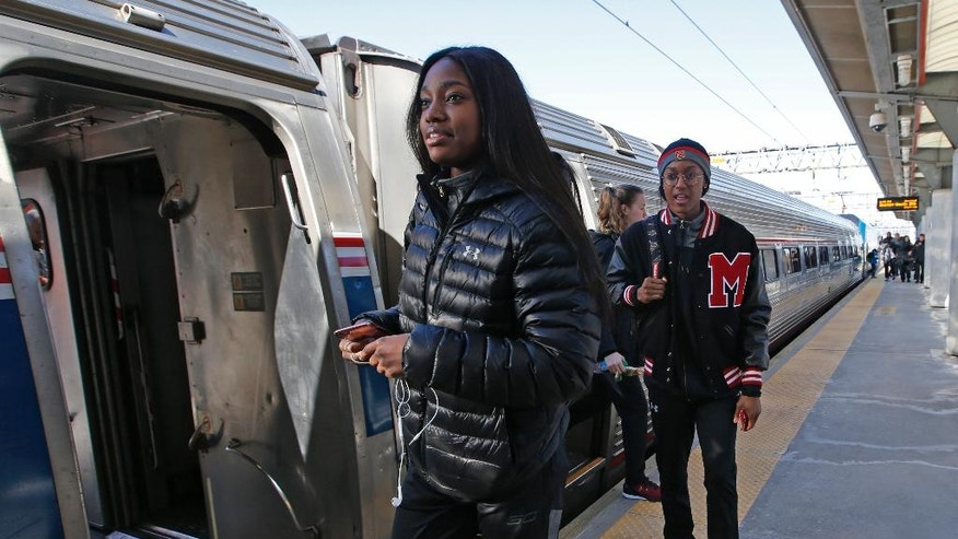 Maryland guards Kaila Charles, left, and Shatori Walker-Kimbrough walk on the platform after riding with their team on an Amtrak Regional train from Baltimore to Stamford, Conn., Thursday, March 23, 2017. Maryland plays Oregon on Saturday in the NCAA women's college basketball tournament Bridgeport Regional. (AP Photo/Kathy Willens)