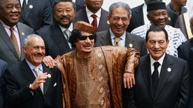 FILE - In this Oct. 10, 2010 file photo, Libyan leader Moammar Gadhafi, center, with Egyptian President Hosni Mubarak, right, and his Yemeni counterpart Ali Abdullah Saleh, left, pose during a group picture with Arab and African leaders during the second Afro-Arab summit in Sirte, Libya. Egypt's ousted former leader Hosni Mubarak was released after six years in prison on Friday, March 24, 2017, but he is not the only ruler in the Middle East to be caught up in Arab Spring uprisings that swept across the region since 2011. Exiled, killed or fighting for their lives, here is a look at the fate of other Arab leaders.(AP Photo/Amr Nabil, File)