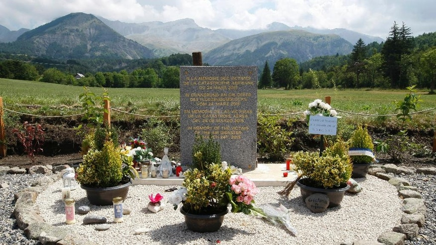 FILE - In this July 24, 2015 file picture a stone slab erected as a monument, set up in the area near where a Germanwings aircraft crashed in the French Alps, in Le Vernet, France. Germanwings co-pilot Andreas Lubitz deliberately crashed the jet into the French Alps on March 24, 2015, killing all 150 people on board. Guenter Lubitz, the father of the Germanwings pilot says his son couldn't have committed such an act. He plans a press conference Friday March 24, 2017. (AP Photo/Claude Paris, file)