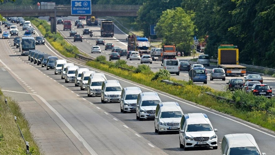 FILE - In this June 10, 2015 file picture, a convoy of hearses drives on the highway in Duisburg, Germany. taking home victims who died in the Germanwings plane crash in the French Alps March 24, 2015. Germanwings co-pilot Andreas Lubitz deliberately crashed the jet into the French Alps, killing all 150 people on board. Guenter Lubitz, the father of the Germanwings pilot says his son couldn't have committed such an act. He plans a press conference Friday March 24, 2017. (AP Photo/Martin Meissner, file)