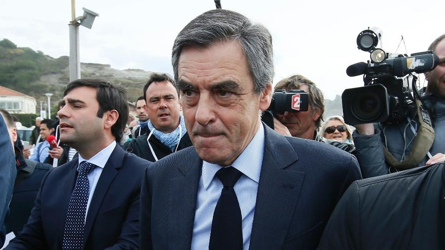Conservative presidential candidate Francois Fillon arrives in Anglet, southwestern France, Friday, March 24, 2017. The clash between the Socialist Hollande and right-wing Francois Fillon threatens to further stain the French presidential campaign, already colored by a stream of corruption scandals and voter frustration with the political establishment. (AP Photo/Bob Edme)