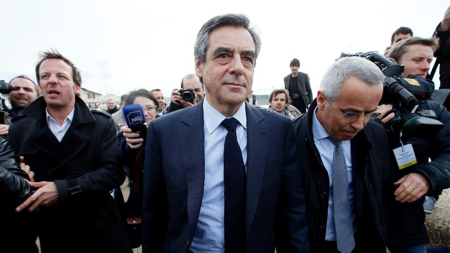 Conservative presidential candidate Francois Fillon, center, arrives in Anglet, southwestern France, Friday, March 24, 2017.The clash between the Socialist Hollande and right-wing Francois Fillon threatens to further stain the French presidential campaign, already colored by a stream of corruption scandals and voter frustration with the political establishment. (AP Photo/Bob Edme)
