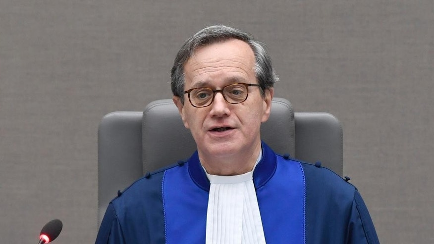 Presiding Judge Marc Perrin de Brichambaut opens the court session prior to delivering the order for reparations to victims in the Germain Katanga case at the International Criminal court in The Hague, Netherlands, Friday March 24, 2017. (Toussaint Kluiters POOL via AP)