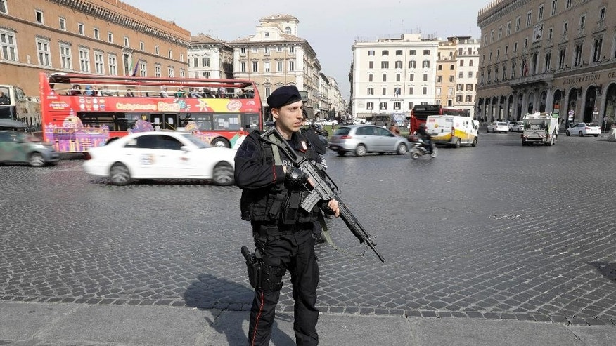 Italian paramilitary police patrol Rome's Piazza Venezia Square, on Friday, March 24, 2017 a day ahead of a European Union summit commemorating the 60th Anniversary of the Treaty of Rome.  EU leaders are gathering in Rome for a summit to mark the EU's 60th anniversary and to outline its future after Britain leaves. (AP Photo/Gregorio Borgia)