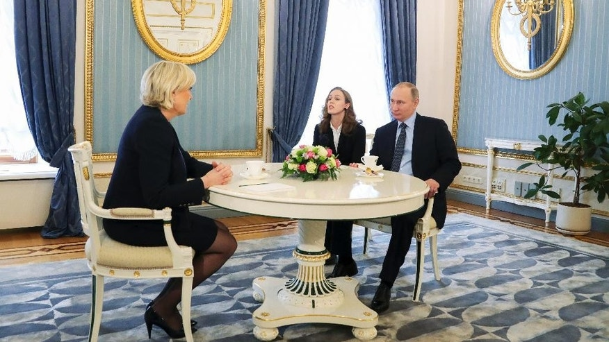 Russian President Vladimir Putin, right, speaks to French far-right presidential candidate Marine Le Pen, left, in the Kremlin in Moscow, Russia, Friday, March 24, 2017. Putin has held a surprise meeting with France's far-right presidential candidate and dismissed suggestions that Russia aims to influence the election in her favor. (Mikhail Klimentyev, Sputnik, Kremlin Pool Photo via AP)