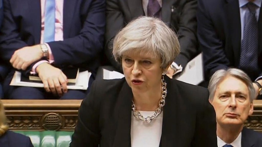 Britain's Prime Minister Theresa May speaks in the Houses of Parliament, Thursday March 23, 2017, following the attack in London Wednesday.  On Wednesday a man went on a deadly rampage, first drove a car into pedestrians then stabbed a police officer to death before being fatally shot by police within Parliament's grounds in London. (PA via AP)
