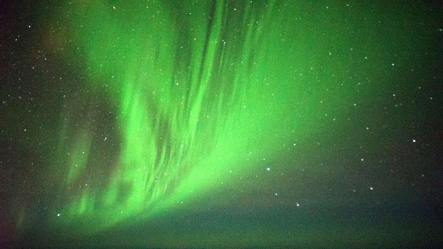 The Southern Lights are seen over the Southern Ocean near Antarctica from a chattered plane Friday, March 24, 2017. A charter plane that left Dunedin, New Zealand, late Thursday flew close to the Antarctic Circle to give the eager passengers an up-close look at the Aurora Australis, or Southern Lights. (Ian Griffin via AP)