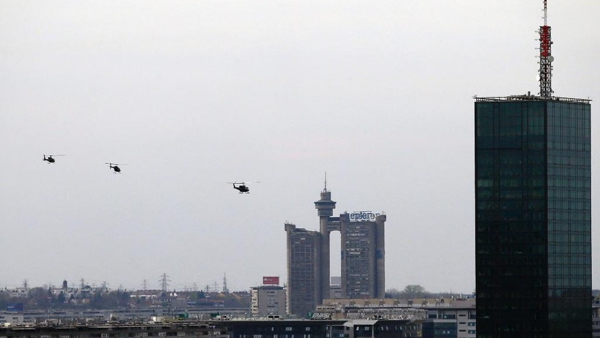 Three Serbian police helicopters fly over the capital, Belgrade, as part of Remembrance Day ceremonies, in Serbia, Thursday, March 23, 2017. Serbia marks the 18th anniversary of beginning of the NATO air-campaign in 1999, on March 24. (AP Photo/Darko Vojinovic)