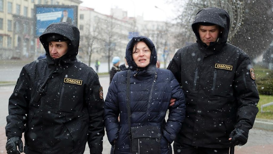 Belarus police detain a woman prior to an opposition rally in Minsk, Belarus, Saturday, March 25, 2017. Over the past two months, protests have broken out across the country of 9.5 million, sometimes attracting thousands — initially they were focused on the labor law but have grown to encompass calls for the resignation of President Alexander Lukashenko, whom critics call Europe's last dictator. (AP Photo/Sergei Grits)
