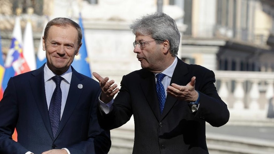 Italian Prime Minister Paolo Gentiloni, right, speaks with European Council President Donald Tusk during arrivals for an EU summit at the Palazzo dei Conservatori in Rome on Saturday, March 25, 2017. EU leaders gather in Rome on Saturday to celebrate the 60th anniversary of the EU's founding treaty. (AP Photo/Andrew Medichini)