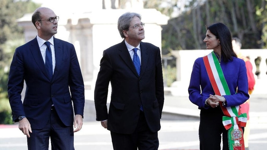 The Mayor of Rome, Virginia Raggi, right, stands with Italian Prime Minister Paolo Gentiloni, center, and Italian Foreign Minister Angelino Alfano, left, during arrivals for an EU summit at the Palazzo dei Conservatori in Rome on Saturday, March 25, 2017. EU leaders gather in Rome on Saturday to celebrate the 60th anniversary of the EU's founding treaty. (AP Photo/Andrew Medichini)