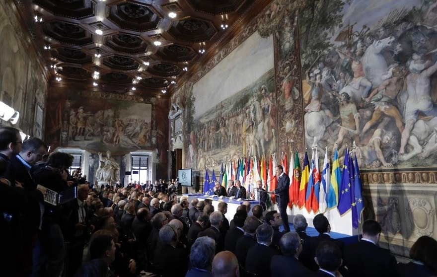 European Council President Donald Tusk, panel right, speaks to EU leaders during an EU summit meeting at the Orazi and Curiazi Hall in the Palazzo dei Conservatori in Rome on Saturday, March 25, 2017. European Union leaders were gathering in Rome to mark the 60th anniversary of their founding treaty and chart a way ahead following the decision of Britain to leave the 28-nation bloc. (AP Photo/Alessandra Tarantino)