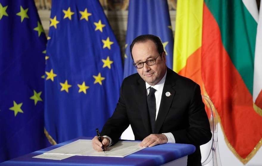 French President Francois Hollande signs a declaration during an EU summit meeting at the Orazi and Curiazi Hall in the Palazzo dei Conservatori in Rome on Saturday, March 25, 2017. European Union leaders were gathering in Rome to mark the 60th anniversary of their founding treaty and chart a way ahead following the decision of Britain to leave the 28-nation bloc. (AP Photo/Alessandra Tarantino)