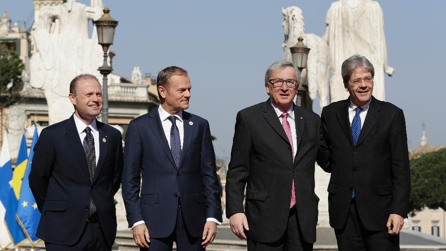 From left, Malta's Prime Minister Joseph Muscat, European Council President Donald Tusk, European Commission President Jean-Claude Juncker and Italian Prime Minister Paolo Gentiloni during arrivals for an EU summit at the Palazzo dei Conservatori in Rome on Saturday, March 25, 2017. EU leaders gather in Rome on Saturday to celebrate the 60th anniversary of the EU's founding treaty. (AP Photo/Andrew Medichini)
