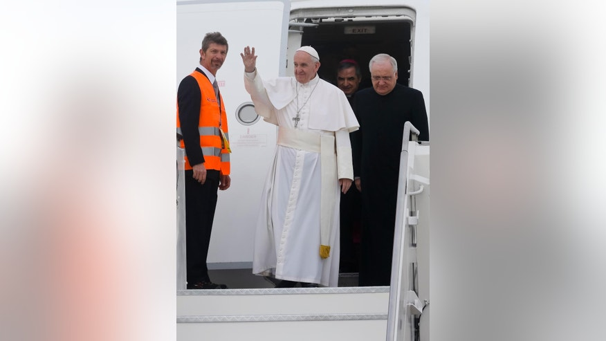 Pope Francis arrives at Milan's Linate airport, northern Italy, for a one-day pastoral visit to Monza and Milan, Italy's second-largest city, Saturday, March 25, 2017. On Friday Francis welcomed 27 EU leaders to the Vatican on the eve of a summit to mark the 60th anniversary of the Treaty of Rome, the founding charter of the bloc. (AP Photo/Luca Bruno)