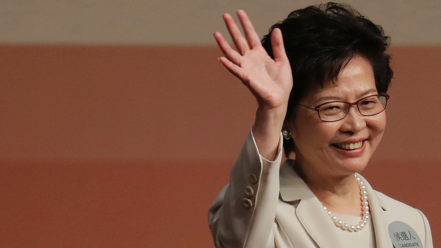 Carrie Lam vows to unite Hong Kong after winning polls