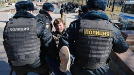 "Police detain a protester in downtown Moscow, Russia, Sunday, May 26, 2017. Russia's leading opposition figure Alexei Navalny and his supporters aim to hold anti-corruption demonstrations throughout Russia. But authorities are denying permission and police have warned they won't be responsible for ""negative consequences"" or unsanctioned gatherings. (AP Photo/Alexander Zemlianichenko)"