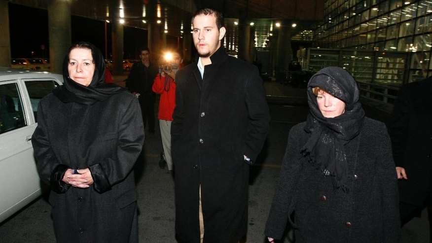 In this Dec. 18, 2007, file photo, Christine Levinson, left, the wife of a missing American former FBI agent, her son, Daniel, and her sister Susan exit Tehran's Imam Khomeini airport upon their arrival in Iran.