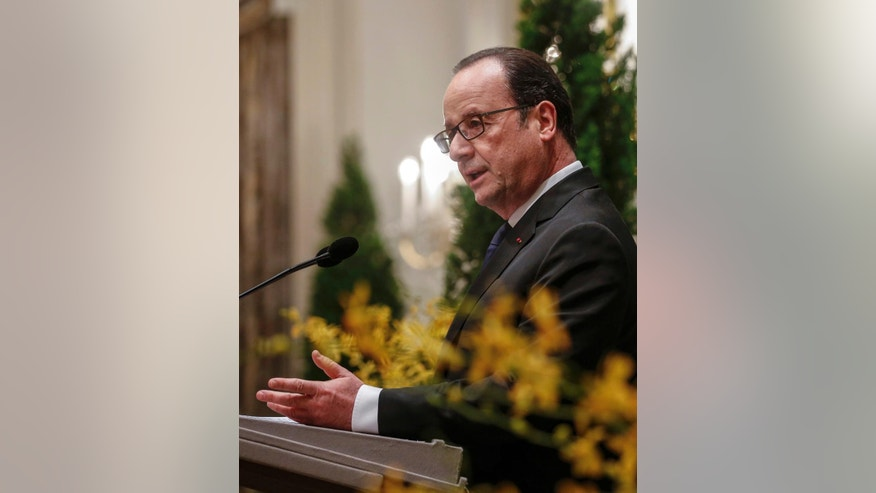 French President Francois Hollande delivers a speech during a state banquet hosted by Singapore President Tony Tan in the Istana or residential palace in Singapore, Sunday, March 26, 2017. Hollande is on a two-day state visit to Singapore. (Wallace Woon/Pool Photo via AP)