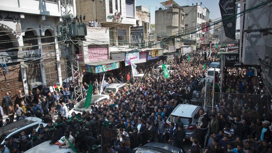 Mourners attend the funeral of Mazen Faqha, in Gaza City, Saturday, March, 25, 2017. The former Palestinian prisoner whom Israel sent to Gaza after his release was found shot dead at the entrance of his house in Gaza City. (AP Photo/ Khalil Hamra)