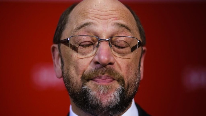 Social Democratic Party, SPD, chairman and top candidate in the upcoming general elections Martin Schulz closes his eyes as he gives a statement after first projections of the state election in German state Saarland have been announced at the party's headquarters in Berlin, Sunday, March 26, 2017. Chancellor Angela Merkel's conservative party has emerged easily as the strongest party from an election in Germany's western Saarland state — an unexpectedly strong performance and a disappointment for her center-left rivals. (AP Photo/Markus Schreiber)