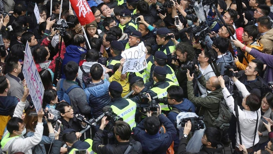 "Protesters scuffle with police officers during a protest against the chief executive election in Hong Kong, Sunday, March 26, 2017. A committee dominated by pro-Beijing elites is casting ballots Sunday to choose Hong Kong's next leader in the first such vote since 2014's huge pro-democracy protests. The system has been criticized by pro-democracy activists as a ""fake election"". (Apple Daily via AP)"
