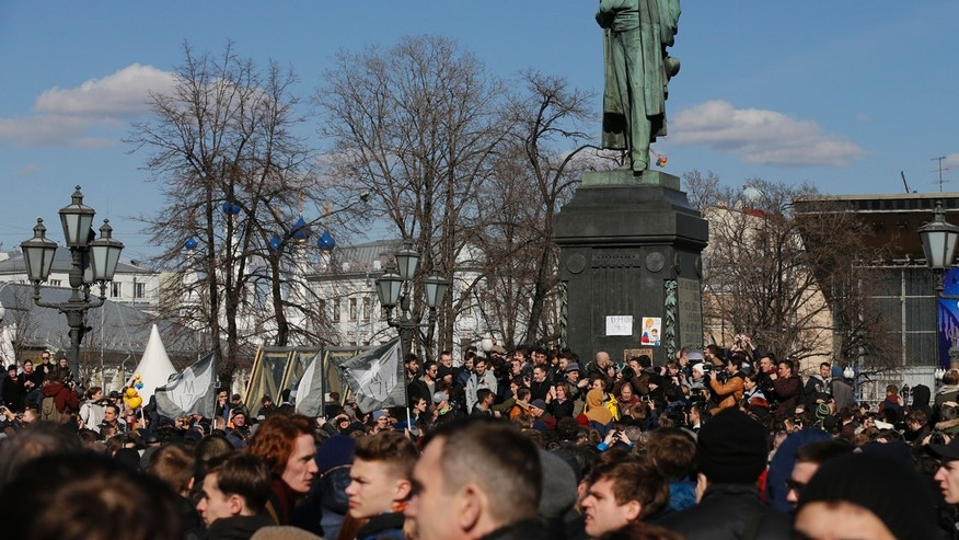 People gather outside Alexander Pushkin monument in downtown Moscow, Russia, Sunday, March 26, 2017.