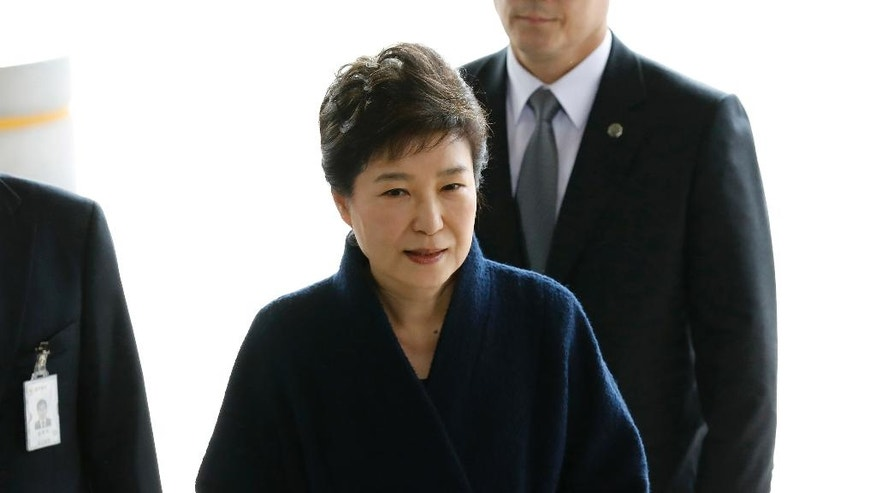 FILE - In this March, 21, 2017 file photo, South Korea's ousted leader Park Geun-hye arrives at a prosecutor's office in Seoul, South Korea.  Media reports say that South Korean prosecutors have decided to ask a court issue a warrant to arrest former President Park Geun-hye on corruption allegations. Yonhap news agency reported Monday, March 27 2017,  that prosecutors reached the decision after they grilled Park last week over suspicions she colluded with a jailed confidante to extort from companies and allowed the friend to secretly interfere with state affairs.(Kim Hong-ji/Pool Photo via AP, File)
