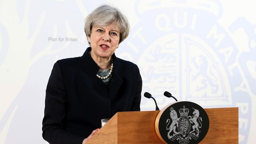 Britain's Prime Minister, Theresa May, gives a speech at the Department for International Development's office at Abercrombie House in East Kilbride  Scotland Monday March 27, 2017.  May will later meet Scotland's leader Nicola Sturgeon  for the first time since they faced off in a struggle over a new push for Scottish independence as the U.K. leaves the European Union.  (Jane Barlow/PA via AP)