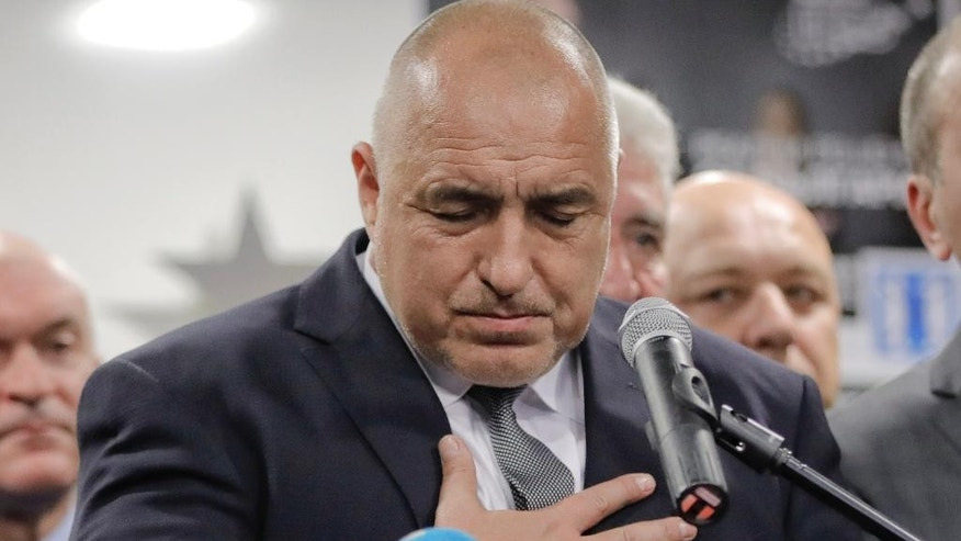 Bulgarian ex-Premier Boiko Borisov, leader of the center-right GERB party, thanks those who voted for his party during a statement at the party's headquarters, in Sofia, Bulgaria, Sunday, March 26, 2017. Bulgaria's center-right GERB party of former Prime Minister Boiko Borisov leads by 4 percent in Sunday's parliamentary elections , according to two separate exit polls conducted by the Alpha Research and the Gallup International Bulgaria polling agencies. (AP Photo/Vadim Ghirda)