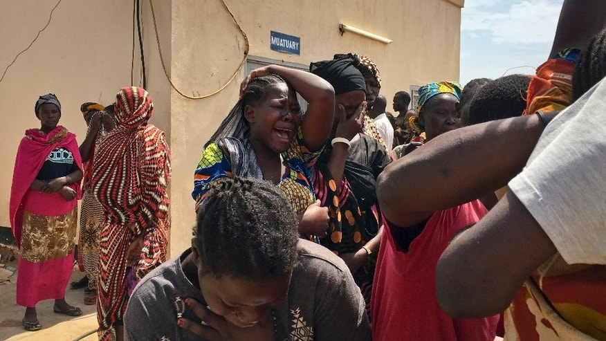 Relatives of the six aid workers who were ambushed and killed grieve as they wait to collect and bury the bodies of their loved ones, outside the morgue in Juba, South Sudan Monday, March 27, 2017. The ambush of the six aid workers took place Saturday on the road from Juba, the capital, to Pibor, and is the latest of several attacks on aid workers in the country where at least 12 aid workers have been killed so far this year and 79 since civil war began in 2013. (AP Photo)