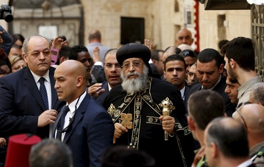Egyptian Coptic Pope Tawadros II (C), head of the Coptic Orthodox church, arrives to  the funeral of Anba Abraham, Coptic Orthodox Metropolitan Archbishop of Jerusalem and the Near East, in Jerusalem's Old City November 28, 2015. Tawadros' attendance comes after a decades-old ban on visiting Jerusalem set by his predecessor, the late Pope Shenouda III. REUTERS/Ronen Zvulun  - RTX1W7W1