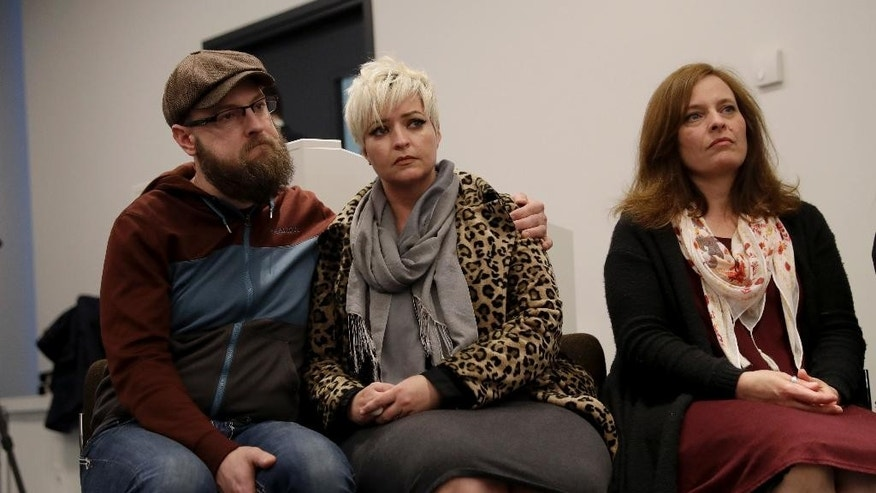 Sisters of U.S. tourist Melissa Cochran, who was injured and her husband Kurt Cochran killed in Wednesday's London attack, Angela, right, and Sara McFarland, center, with her husband Jason McFarland, listen during a press conference with family members at New Scotland Yard, the headquarters of London's Metropolitan Police force, in London, Monday, March 27, 2017. Pictured listening are family members, Melissa's sisters Sara McFarland, second left, Jennifer Burton, third left, Angela, right, and Sara's husband Jason McFarland, left. (AP Photo/Matt Dunham)