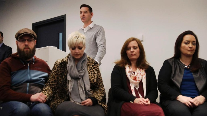 Clint Payne, the brother of U.S. tourist Melissa Cochran, who was injured and whose husband, Kurt Cochran, was killed in Wednesday's London attack, speaks at a podium during a press conference with family members at New Scotland Yard, the headquarters of the Metropolitan Police force, in London, Monday, March 27, 2017. Listening are family members, Melissa's sisters Sara McFarland, second left, Jennifer Burton, third left, Angela, right, and Sara's husband Jason McFarland, left. (AP Photo/Matt Dunham)